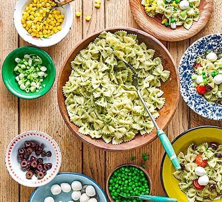 Pick & mix pesto pasta salad bar arranged in bowls