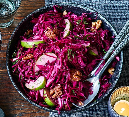 A bowlful of pickled red cabbage with walnuts & apple