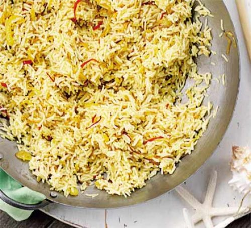 Bowl of turmeric pilau rice with onions