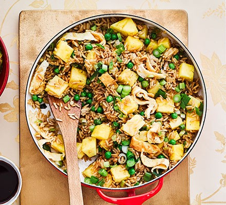 Pineapple fried rice served in a large dish
