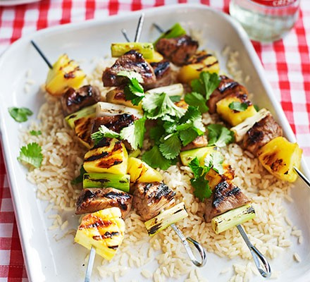 Pineapple & pork skewers served on a bed of rice