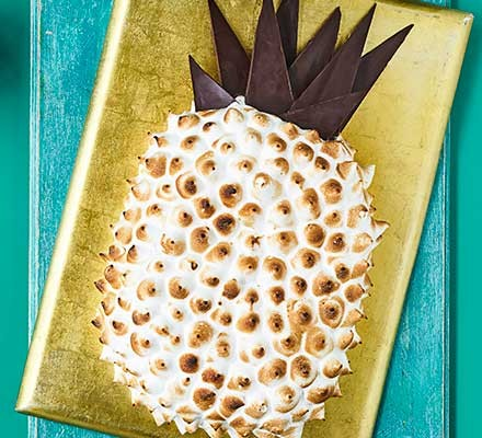 A gold serving board with a pineapple & rum cake