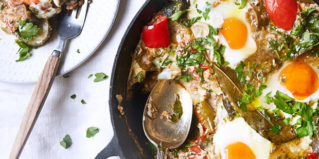 Ratatouille with eggs in serving dish with spoon