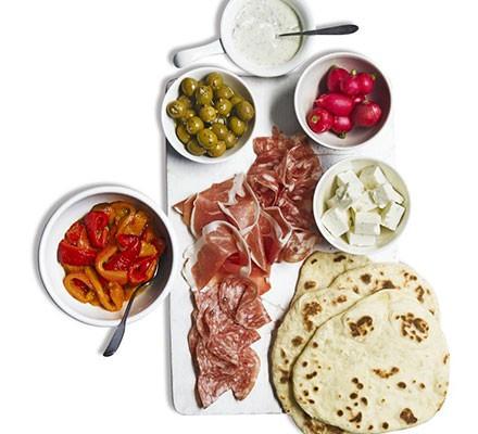 Antipasti platter with homemade flatbreads