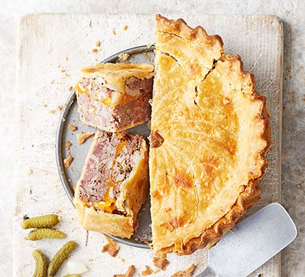 Ploughman's pork & cheese picnic pie served cut into slices