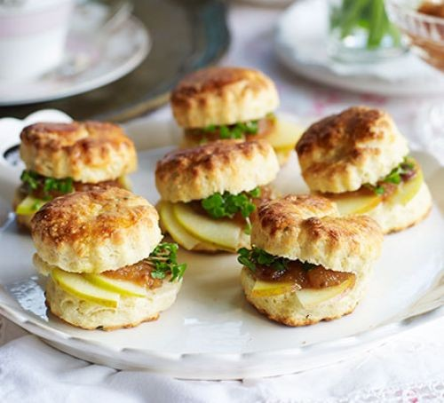 Scones with cheddar and chutney on plate