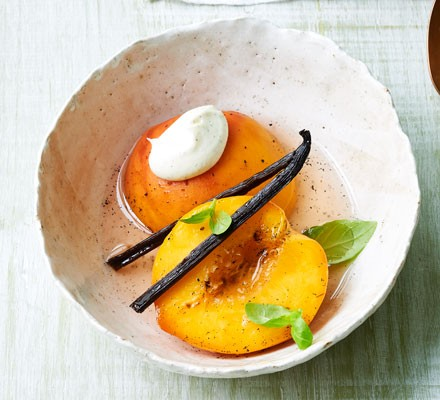 Poached peaches in sparkling wine with basil & vanilla