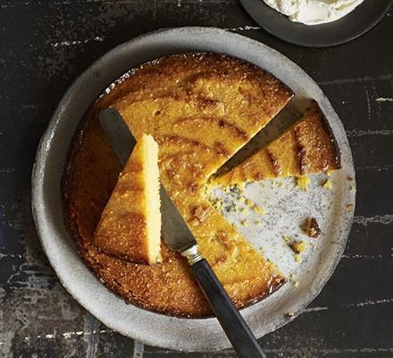 Sliced flourless lemon & polenta drizzle cake