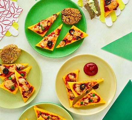 Mini polenta pizza bites on small coloured plates