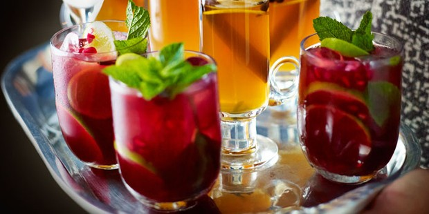 Pomegranate cocktails with mint on tray