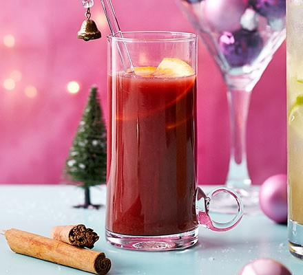 Pomegranate & vermouth mulled wine served in a tumbler glass