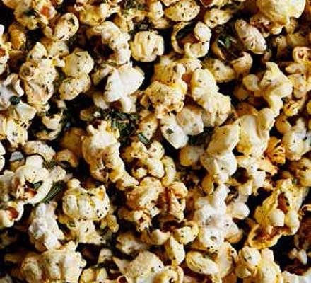A close up of rosemary, garlic & chilli popcorn