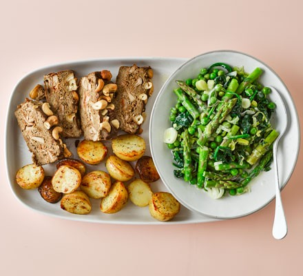 A porcini mushroom loaf with green vegetables and potatoes