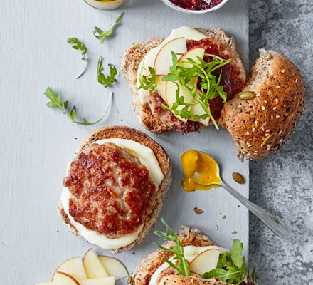 Burgers topped with apple slices and salad