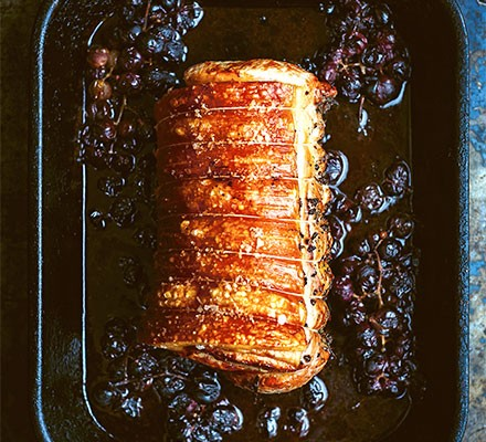 Roast pork with crushed grapes, marsala & juniper served in a roasting dish