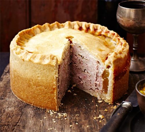 Raised pork pie with slice taken out