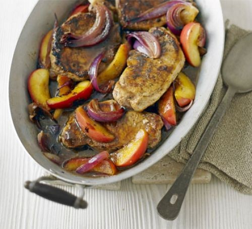 Oval one-pot of pork loin steaks, fruit and vegetables