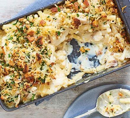 A casserole dish serving macaroni & smoked haddock bake