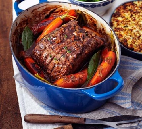 pot-roast beef in a blue pot with carrots