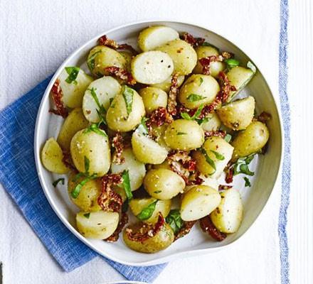 Bowl of new potato and sundried tomato salad