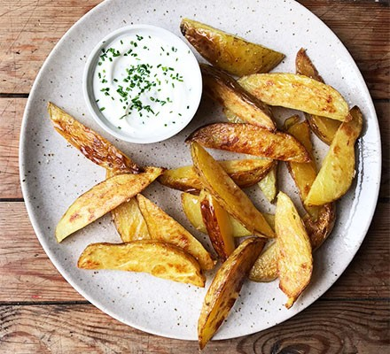 Potato wedges served with soured cream
