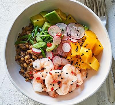 poke bowl with prawns, mango, avocado and rice