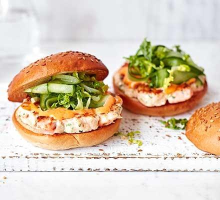 Two prawn & salmon burgers with green salad