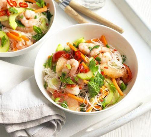 Bowls of prawn, grapefruit and rice noodle salad