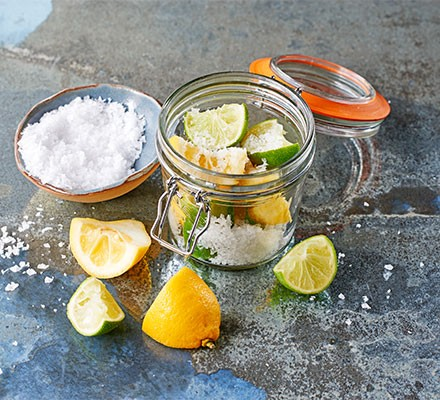 A jar with preserved lemon & lime squeezes