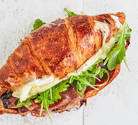A croissant filled with prosciutto, cranberry sauce & brie