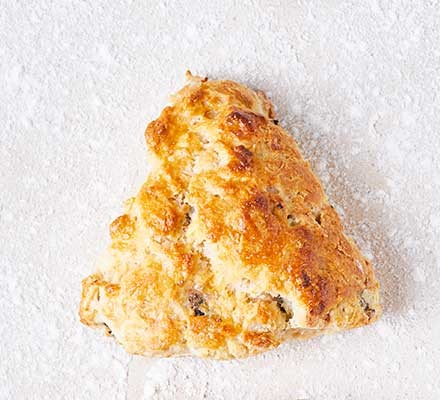 Prune & almond scone on a floured surface
