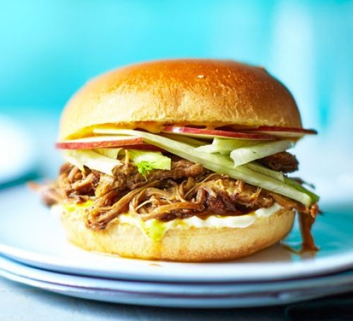Pulled pork and vegetables in a burger bun