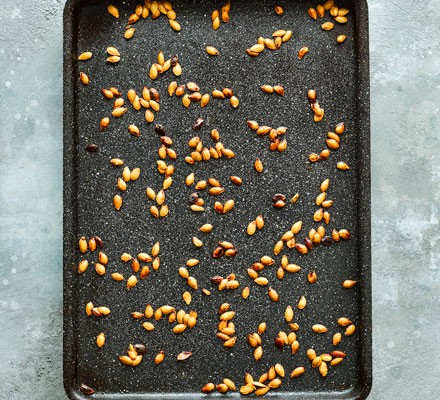Pumpkin seeds on a baking tray