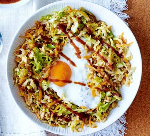 Nasi goreng in bowl with sauce