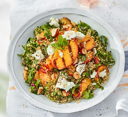 Quinoa, goat's cheese & peach salad served on a plate