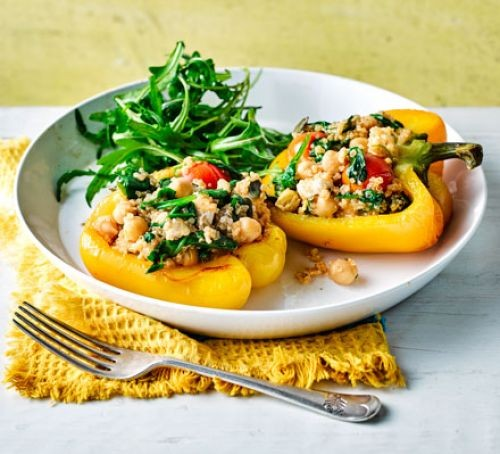 Stuffed roasted peppers on plate with salad