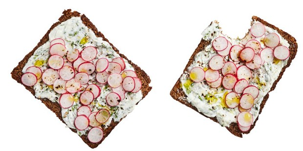 Smorebrod cracker topped with sliced radishes and cream