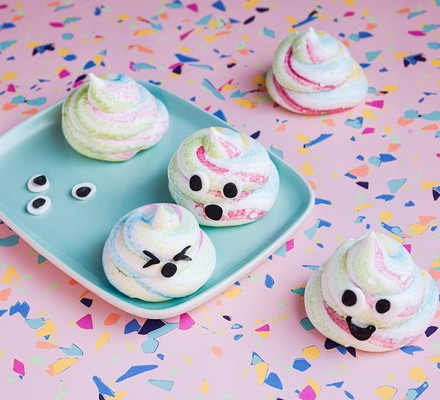 Rainbow-coloured meringue kisses with eyes and mouths