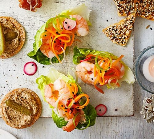 Three lettuce cups filled with prawn cocktails, plus crackers