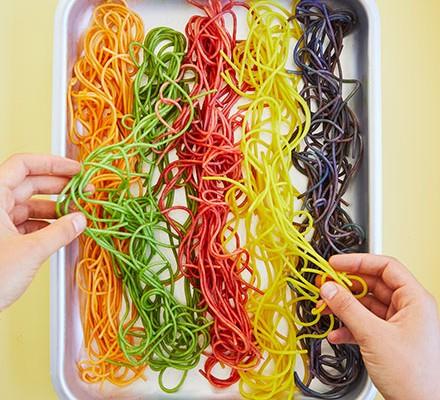 Rainbow spaghetti in a tray