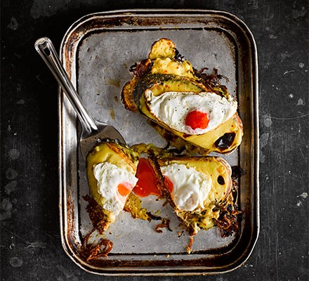 Rarebit toasties with sticky Marmite onions served with eggs on a tray