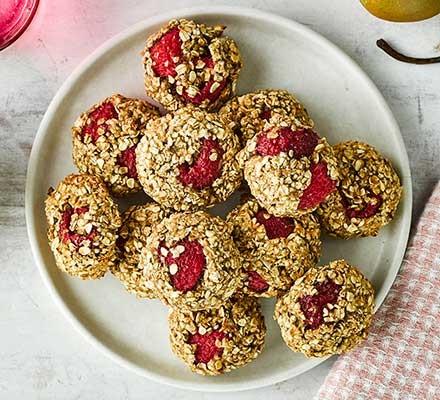 Raspberry, almond & oat breakfast cookies served on a plate