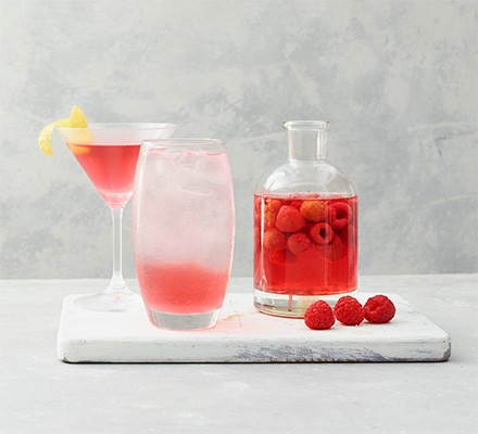 Flavoured raspberry gin in bottle and glass