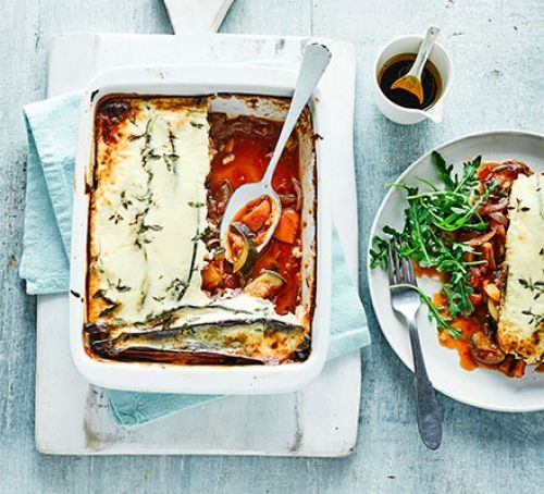 Ratatouille & parmesan bake on an oven dish and plate with rocket side