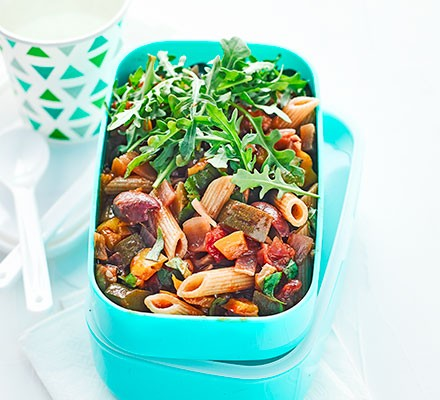 A lunchbox with ratatouille pasta salad with rocket