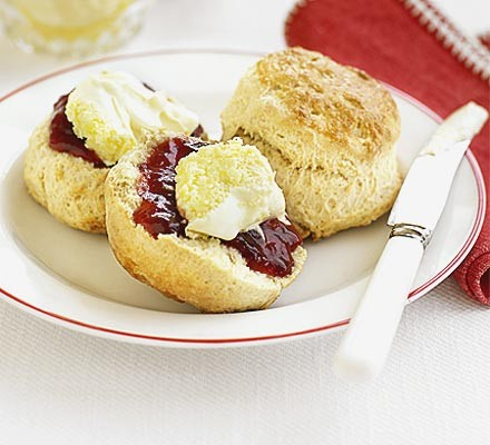 Scones with jam & clotted cream on a plate