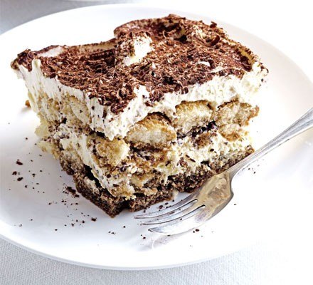 Slice of tiramisu on a serving plate