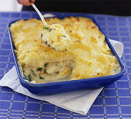 Fish pie in a large rectangular dish with serving spoon