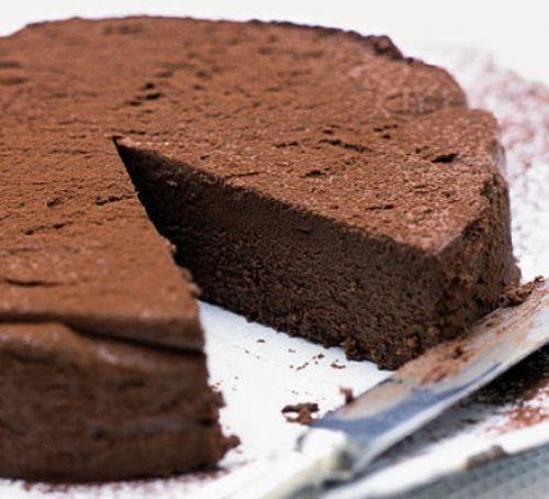 Chocolate torte with slice cut
