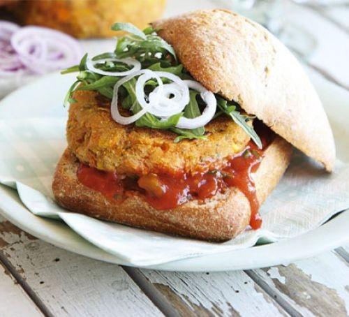 Burger with salad and ketchup in bun